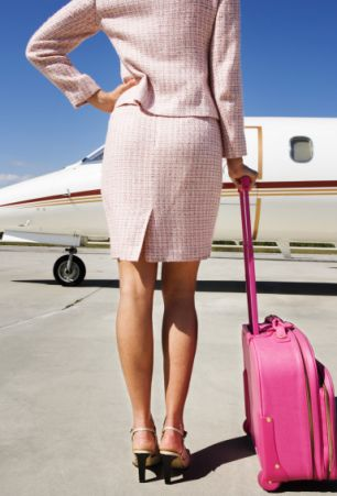 Businesswoman Waiting on Airport Runway