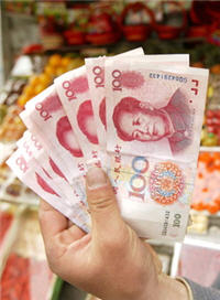 Singapore May Weaken Currency in January on Yuan