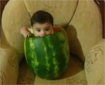 Video: Cute Baby Eats Watermelon from inside